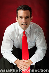 TWNhw1675 (Henry Westheim Photography) Tags: camera red portrait people white man male shirt neck studio person one 1 photo clothing sitting looking view shot adult stock formal handsome tie indoor front clothes business suit half inside years length seated confident ethnicity confidence caucasian attire 3035
