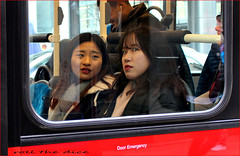 `1900 (roll the dice) Tags: london w1 westend westminster londonist glass bus window reflection pretty sexy girls surreal odd sad mad funny reaction streetphotography passenger fashion shops shopping korean chinese people wisdom natural urban england uk classic art tourism canon unaware unknown look portrait happy strangers candid colour brave close eyes escape emergency seen weather cold mouth oxfordstreet music