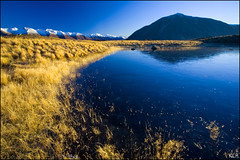 Frozen tarn (katepedley) Tags: new morning blue winter newzealand lake snow mountains reflection ice grass canon golden frozen interestingness pond basin explore zealand fieldtrip mackenzie valley southisland mackenziecountry 5d rps tarn southernalps tussock 1740mm moraine ohau twizel omarama polariser glaciated canterburynz specland theinterestingshot