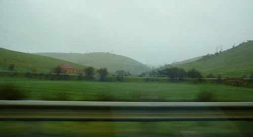 3 of 12: Rainy Landscape out the car window
