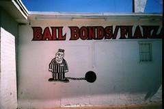 ball and chain (Gigi Elmes) Tags: film lasvegas walls advertisements vivitar uws fuji400 paintedsigns