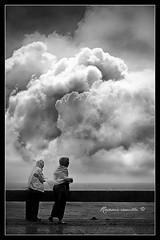 rain watchers (rosevie) Tags: two blackandwhite rain clouds philippines raincoat rainwatchers