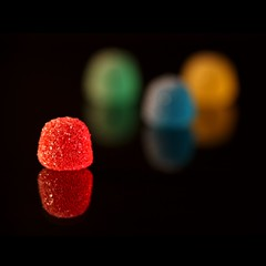 bejeweled: 298/365 (helen sotiriadis) Tags: blue red food black macro green yellow closeup canon dof candy sweet bokeh depthoffield 365 gumdrops canonef100mmf28macrousm canoneos40d toomanytribbles