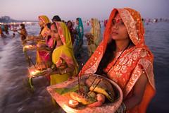 Chhath Puja (Ashish T) Tags: ocean sea woman sun india men colors festival night canon lowlight women worship colorful indian religion tokina celebrations ritual mumbai hindu hinduism puja prayers 1224 chhath 40d socialaffairs ashishtibrewal