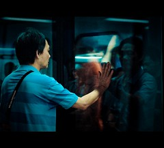 HongKong: In search of himself~ (Vu Pham in Vietnam) Tags: china lighting street hk night underground subway hongkong movement metro bokeh candid streetphotography nightlight  dailylife mrt  kowloon vu 2009 tsimshatsui centralhongkong mtr 500d canon500d  hongkongphotos dulch cucsng trungquc trunghoa conngi chu platformdoors khchdulch raininvietnam hkwalk commentwithimageswillbedeletedsosorryforthis