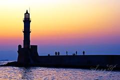 Silhouettes at Sunset. (Pink Pixel Photography (f.k.a. Sunny)) Tags: sunset lighthouse silhouettes greece crete summervacation chania omgosh canoneos400d gaaaaaah againicannotthinkofanytitle yourversionturnedoutsooooobeautiful