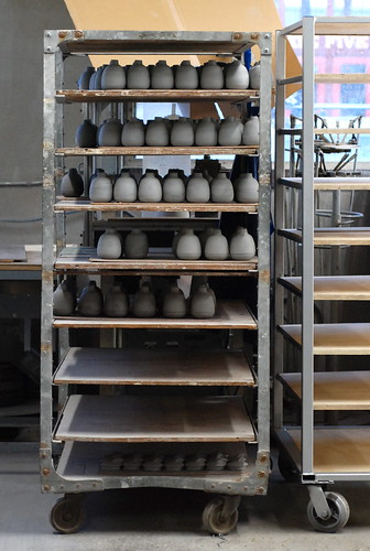 shelves of bud vases