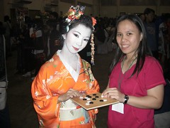 Geisha plays Go (michaelgalero) Tags: game anime booth cosplay no board baduk go fair 2009 ame weiqi jidai