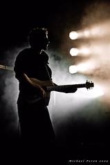 On the air... (Michael Peron...Happy new year) Tags: light musician music art festival concert pentax guitar smoke scene spot beam attitude vision human rights lumiere posture homme musique regard guitare musicien fume humain scne faisceau k20d justpentax trucataoules pentaxart michaelperon tipstaoli