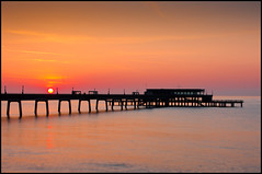 Deal Pier at Sunrise (Mr Aperture1977) Tags: morning pink sea england orange sun art beach water yellow sunrise paul photography dawn coast pier early photo kent cafe long exposure photographer tide shore end deal coastline spree