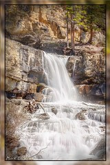Waterfall at Icefield Parkway (Mark Lagerweij) Tags: trees canada mountains wet water canon geotagged rockies waterfall rocks framed geocoded rocky gimp blurred roadtrip alberta parkway linux gps opensource rosepetal lettherebelight kipi icefieldparkway digikam clck beautifulshot perfectcomposition frameit addictedtophotography beautifulcapture 40d photolovers amazingphotography amomentarylapseofreason flickraward canadamedal artoflight diamondstars thirdlife thephotodistillery screamofthephotographer freedomhawk paololivornosfriends doubledragonawards photographersworld micarttttworldphotographyawards artofimages dragonflyawards creativeyeuniverse amsterdambloggingworkshop phoddstica addictedtonature mindigtopponalwaysontop dartworks marklagerweij photostoread flickrnoobs
