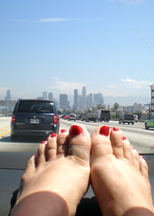 Riding into Downtown Los Angeles (Ari Lynn Day) Tags: city blue red hot cute sexy cars feet car skyline lady foot losangeles highway shiny toes downtown pretty toe painted 110 bluesky riding freeway barefoot barefeet pedicure downtownla dashboard ontheroad toenails redtoenails feetondash