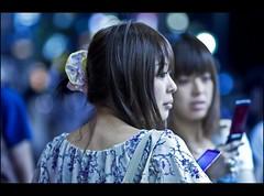 Dolls & phones (Fabio Sabatini) Tags: girl japan canon japanese tokyo blog shinjuku dof bokeh 100mm outoffocus depthoffield 日本 東京 f2 boke 新宿区 新宿駅 shinjukuku 本州 暈け