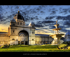 The Royal Exhibition Building, Melbourne (III):: HDR (Artie | Photography :: I'm a lazy boy :)) Tags: sunset sky cloud building classic fountain grass stone architecture photoshop canon cs2 tripod australia melbourne wideangle victoria exhibition structure dome 1020mm hdr nineteenthcentury artie carltongardens royalexhibitionbuilding 3xp sigmalens photomatix tonemapping tonemap 400d rebelxti lalandscape
