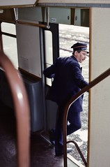 Everyday PKP  |  Wolsztyn, Poland  |  1996 by keithwilde152 - With a glance back along his train standing on platform 2, the  guard prepares for the 12.48 departure to Leszno headed by Ol49-81. Made of the regular 4x double-deck stock. 2nd March 1996