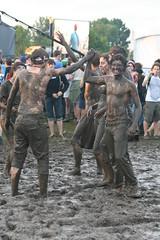 Muddy high five (Sousveillance) Tags: newjersey concert hipsters jerseycity mud nj jc 2009 musicfestival apw libertystatepark allpointswest