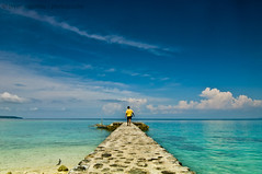 Into The Blue (B2Y4N) Tags: blue tourism beach nature yellow shirt clouds wow alone philippines resort bryan pearlfarm davaocity kadayawan b2y4n bryanrapadas