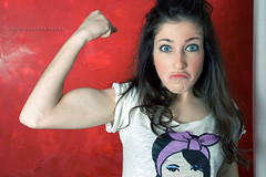 Strong (Aurora Demasi) Tags: red selfportrait girl arm muscle expression background flash aurora strong tamron 20years twentyyears tamron1750 bellefacce