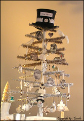 Merry Christmas tinsel tree (Boxwoodcottage) Tags: christmas wood white black tree glass hat leaves bells vintage silver star doll charlotte head top painted watch bisque silk balls jewelry garland sparkle ornaments tinsel pocket cones papiermach soldered bottlebrushtree