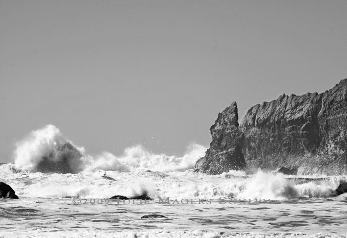 black and white photograph taken at Second Beach in Olympic National Park of the breakers coming in and crashing against the rocky shoreline