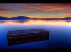 Louder Than Thunder (Philerooski) Tags: wood longexposure blue trees sunset sky orange lake mountains brick cars beautiful yellow night clouds canon reflections eos rebel lights evening washington amazing dock highway perfect glow phil rope symmetry hills frame wa bouy float hdr highdynamicrange borders xsi diamondlake 3xp photomatix 450d philerooski