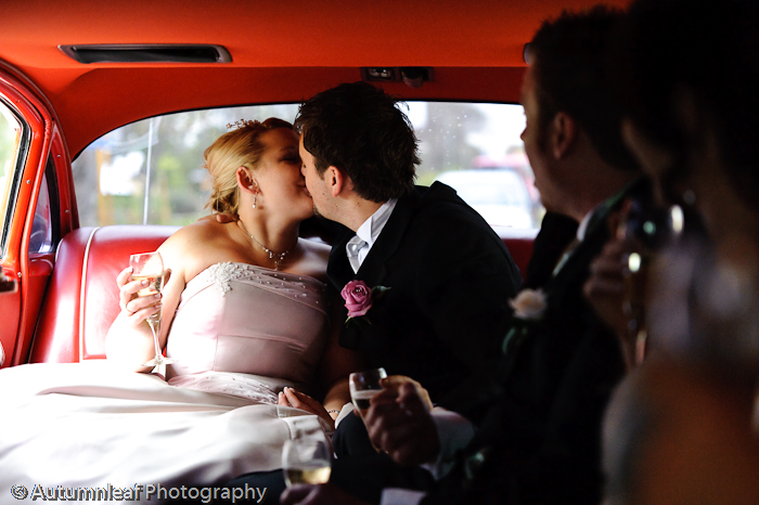 Prue & Paul's Wedding - Kisses in Limo (by Autumnleaf Photography)