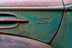 Ford truck side (janet little jeffers) Tags: ford truck vintage logo typography junk rust industrial decay junkyard 2009 truckgraveyard carweb