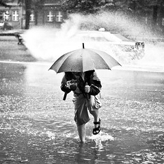 rainy walk (moionet) Tags: summer man water car rain umbrella pond photographer explore photowalk splash 2009 34 gliwice unusualseasons moionet