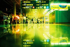 Airside... (Trapac) Tags: barcelona summer people signs reflection green film yellow shopping walking leaving lights airport xpro crossprocessed spain waiting neon fuji bcn olympus catalonia slidefilm xa2 espana busy catalunya olympusxa2 departures dutyfree informationoverload sensia rh killingtime 100iso fujisensia floorshot wmh fujirh roll13 airside barcelonainternationalairport elpratdellobregataeropuerto gtap11022010