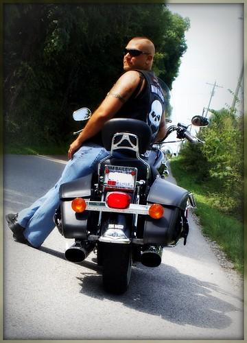 Stud on his bike