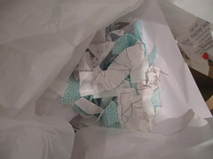 scraps of fabric and paper from foiled attempts