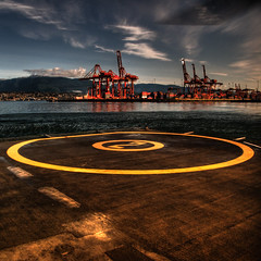Helipad 2 (ecstaticist) Tags: sky cloud vancouver port circle high downtown dynamic crane north aerial helicopter shore range hdr helipad helijet photomatix