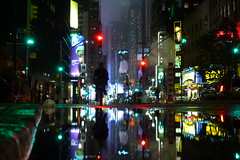 Near Times Square (Airicsson) Tags: show street new york city nyc usa ny david reflection water rain bicycle night america square island lumix lights us jay time theatre manhattan district magic broadway award panasonic midtown passion times avenue letterman leno twop lx3 magicpicture
