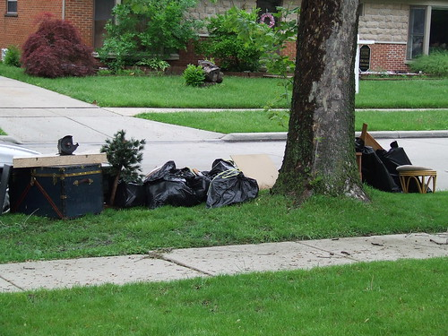 Ruined belongings at curb