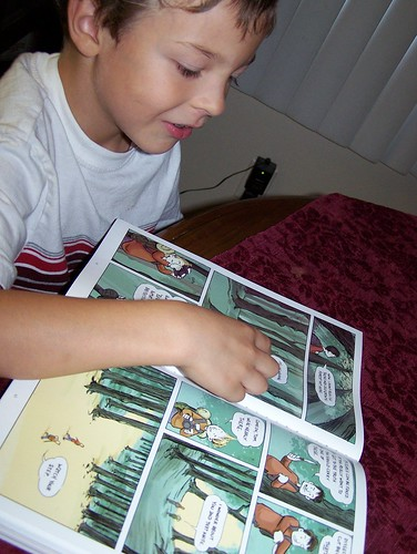 my son reading The Edge a story within Volume 3 of the comic Flight
