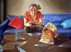 Kill all the bad guys (Linnea Strid) Tags: pink blue playing girl hair table video energy drink patterns games linnea sofa snacks cloth cushions strid