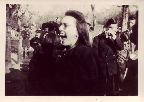 crowd with big mouthed woman 1940s