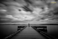 The Quietus (djniks) Tags: seattle sky bw man pier long exposure alone dynamic 110 apocalypse sigma stephen filter nd lakewashington end flickrblog bellevue hdr blackandwhitesky nikky sigma1020 10stop canon40d monochromesky bw110ndfilter nikkystephen