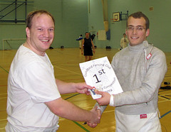 Richard receives the winner's certificate trophy from Matthew Gourlay