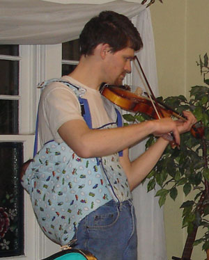 hubby playing violin with baby on his back