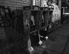Three Bells (sniderscion) Tags: street city urban bw white toronto ontario canada black public night booth dark scott three nikon downtown shadows phone bell telephone grain gritty canadian trio tamron f28 abused snider d80 1750mm tamronspaf1750mmf28 sniderscion