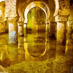 Water Temple (Ancient Arab Underground Cistern, SXII, Cáceres, Spain) (G.Roca) Tags: ancient tank cistern aljibe reflection gold orange rainwater grunge underground dark spain caceres green water cáceres arab meditative