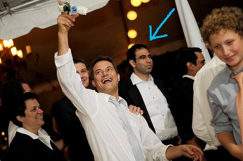My cousin caught the garter. Eytan, in the background, looks totally bummed about it.