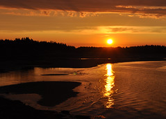 Fire, Burning Me Up (Anything Works) Tags: sunset red sky orange sun reflection water silhouette clouds fire waves novascotia cottage ripples lowtide