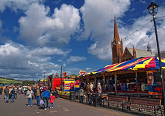 When the Fair Comes to Town (edowds) Tags: carnival blue sky people church fun scotland fair spire promenade 2009 ayrshire largs