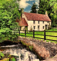Tintern cottages and brook (John the Neath) Tags: autumn trees water fence waterfall sticks nikon stones lawn brook tintern cottages d90 golddragon platinumheartaward saariysqualitypictures tisexcellence newgoldenseal