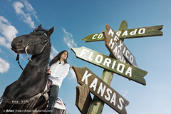 road sign and indian (jk.jkitan) Tags: road ranch old blue wild summer sky people horse cloud white man west male nature beauty animal sign shirt america vintage mexico outdoors person one wooden cowboy colorado ride florida native indian plate riding american western marker kansas choice crossroad roadway hawai