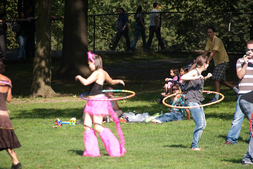 girl in a cat costume hula hooping in Central Park