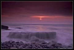 SUNSET AT THE BAY, WALES (IMAGES OF WALES.... (TIMWOOD)) Tags: pink sunset sea wales coast rocks purple sony pebbles filter slowshutter alpha valeofglamorgan bridgend southerndown bristolchannel unusualrocks a700 dunravenbay unusualrockformations