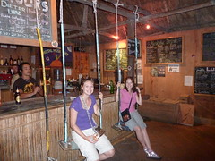 Maree and me sitting on the swings at the bar.